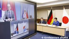 1st Japan-Germany 2-plus-2 talks - Japanese Foreign Minister Toshimitsu Motegi (2nd from R) and Defense Minister Nobuo Kishi (R) are pictured in Tokyo on April 13, 2021, during a so-called two-plus-two dialogue via teleconference with their German counterparts Heiko Maas and Annegret Kramp-Karrenbauer, the first of its kind. (Kyodo)