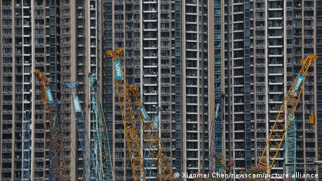 Cranes and building sites in front of high-rise buildings in Hong Kong
