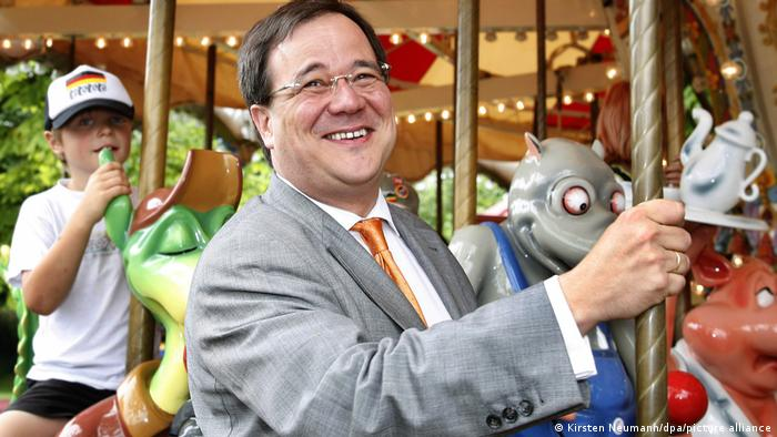 Armin Laschet riding a merry-go-round in 2006