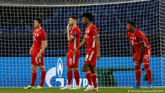 Bayern defenders look on