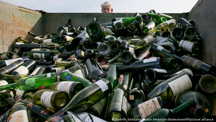 More than 500 bottles of counterfeit wine are destroyed at the Texas Disposal Systems recycling and compost facility in Austin, Texas, on Thursday, Dec. 10, 2015.