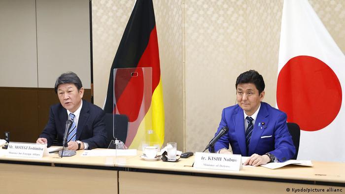 Japan's Foreign Minister Toshimitsu Motegi (L) and Defense Minister Nobuo Kishi