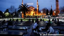 Muslims eat their Iftar (breaking fast) meals in front of the Ottoman-era Sultanahmet mosque, also known as the Blue Mosque, on the first day of the holy fasting month of Ramadan in Istanbul, Turkey April 13, 2021. REUTERS/Umit Bektas