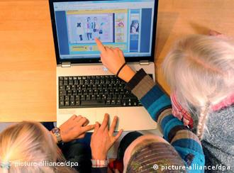 Children pointing at computer screen