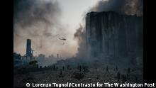 1st Prize Port Explosion in Beirut Lorenzo Tugnoli, Italy, Contrasto BEIRUT, LEBANON - AUGUST 4: Firefighters work to put out the fires that engulfed the warehouses in the port of Beirut after the explosion. (Photo by Lorenzo Tugnoli/ Contrasto for The Washington Post)