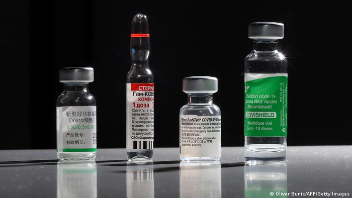 Vials of CVID-19 vaccines from different makers.