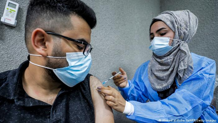 A nurse administers a dose of the Pfizer-BioNTech COVID-19 coronavirus vaccine at a vaccination centre in the Kindi Hospital in Iraq's capital Baghdad.