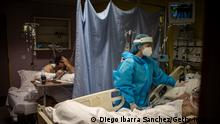 A Lebanese nurse checks the condition of a Covid patient at the Intensive Care Unit of Saint Georges Hospital, in Beirut.