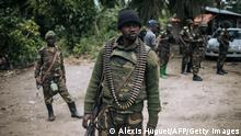 An Armed Forces of the Democratic Republic of Congo (FARDC) soldier takes part in a foot patrol in the village of Manzalaho near Beni on February 18, 2020, following an attack allegedly perpetrated by members of the rebel group Allied Democratic Forces (ADF). (Photo by Alexis Huguet / AFP) (Photo by ALEXIS HUGUET/AFP via Getty Images)