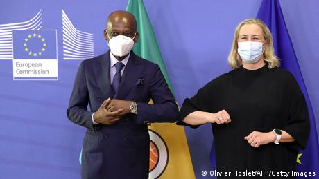 Togolese foreign minister Robert Dussey and EU Commissioner for International Partnerships Jutta Urpilainen elbow bumping