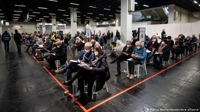 People wait to get vaccinated at a center in Northrhine Westphalia