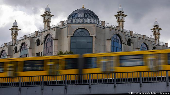 A subway train drives past the Omar Mosque in Berlin's Kreuzberg district. April 2021.