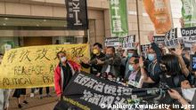 HONG KONG, CHINA - APRIL 16: Pro-democracy activist and former lawmaker Lee Cheuk-yan and Cyd Ho shout slogans at West Kowloon court ahead of a sentencing hearing on April 16, 2021 in Hong Kong, China. Seven prominent democratic figures, including Apple Daily founder Jimmy Lai, former lawmaker and barrister Martin Lee and Margaret Ng, were convicted of unauthorized assembly in relation to a peaceful protest on Aug.18 in 2019. (Photo by Anthony Kwan/Getty Images)