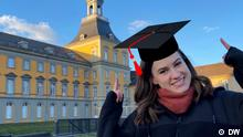 Meet the Germans host Rachel Stewart wearing a graduation hat.