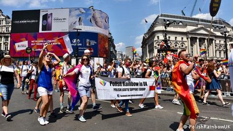Polish flags fly in London's Leicester Square during Pride 2018