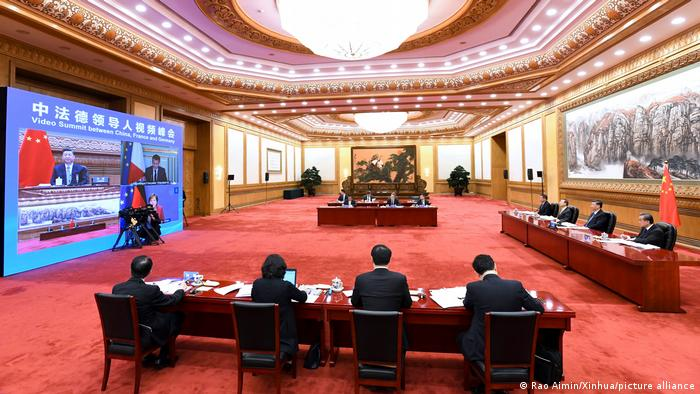 Chinese President Xi Jinping attends a video summit with French President Emmanuel Macron and German Chancellor Angela Merkel