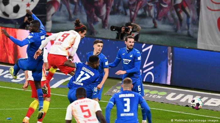 RB Leipzig's Yussuf Poulsen heads in a late disallowed goal.