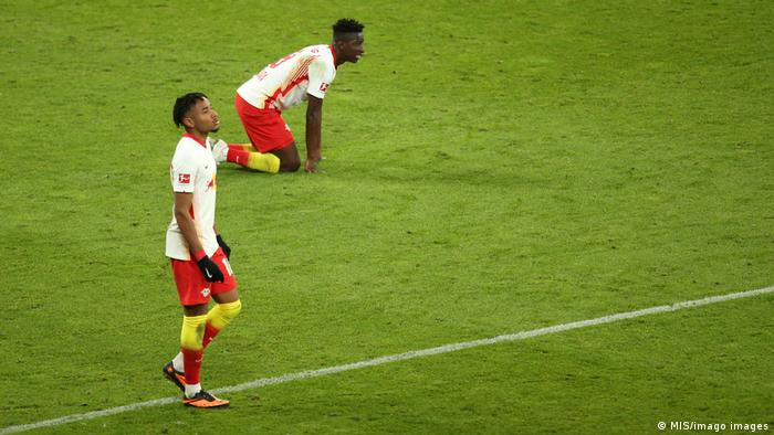 RB Leipzig's Christopher Nkunku and Amadou Haidara are disappointed at full time