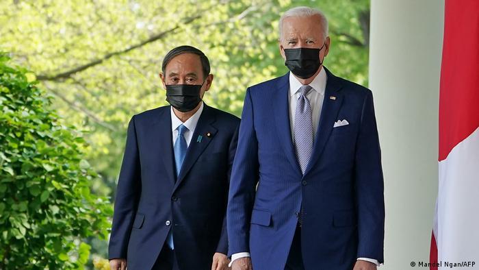 USA Joe Biden and Yoshihide Suga wear black surgical face masks