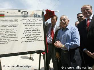 Palestinian Authority Prime Minister Salam Fayad (centre) and Dirk Niebel (right) during the opening of the Sewerage Project in