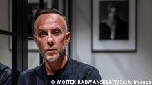 Adam Darski, leader of Polish black metal band Behemoth, poses during an AFP interview in his apartment in Warsaw, Poland, on March 25, 2021. - The artist, better known as Nergal -- the name of an ancient Babylonian demon, has launched a crowdfunding campaign to fight multiple prosecutions against him and help others do the same. (Photo by Wojtek RADWANSKI / AFP) (Photo by WOJTEK RADWANSKI/AFP via Getty Images)