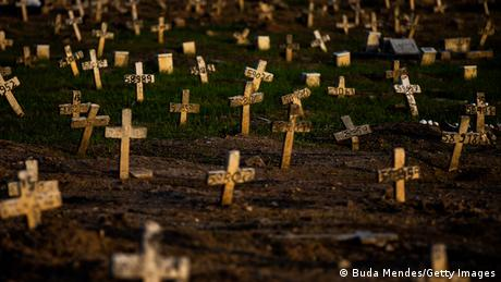 A general view at Caju cemetery on March 24, 2021 in Rio de Janeiro shows dozens of small crosses with numbers