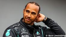 Mercedes' British driver Lewis Hamilton reacts after the qualifying session on the eve of the Emilia Romagna Formula One Grand Prix at the Autodromo Internazionale Enzo e Dino Ferrari race track in Imola, Italy, on April 17, 2021. (Photo by Bryn Lennon / various sources / AFP)