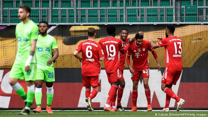 Jamal Musiala celebrates his second goal against Wolfsburg with his Bayern teammates