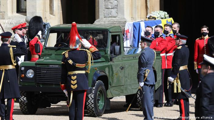 Philip's coffin is being taken off the Land Rover by soldiers
