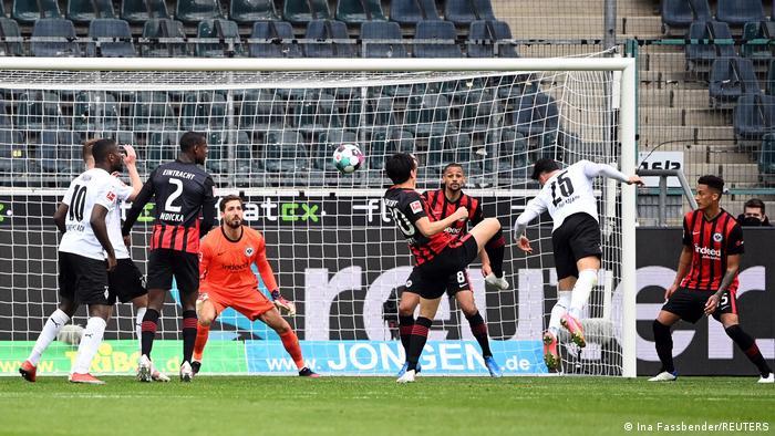 Ramy Bensebaini heads home Borussia Mönchengladbach's third goal in their 4-0 hammering of Eintracht Frankfurt