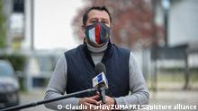 Matteo Salvini speaks to reporters wearing an Italy face mask