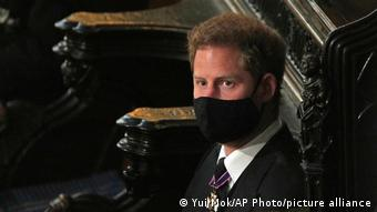 Prince Harry sitting alone during Philip's memorial service