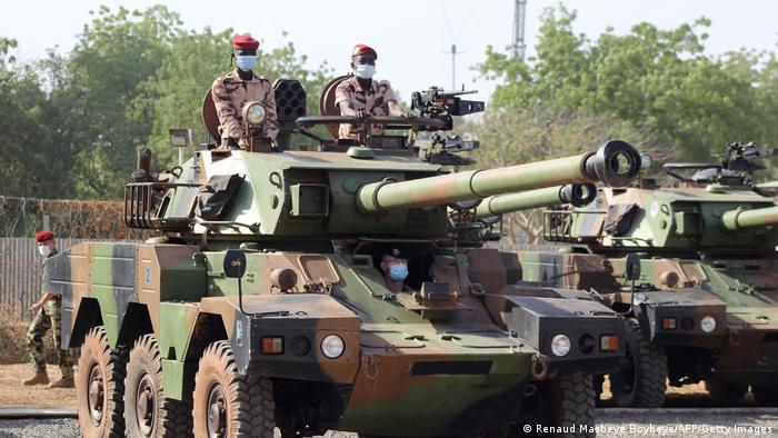 Chadian soldiers in a light armored vehicle