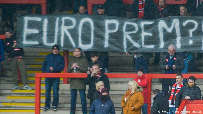 FC United of Manchester supporters display a banner opposing the idea of a European Super League