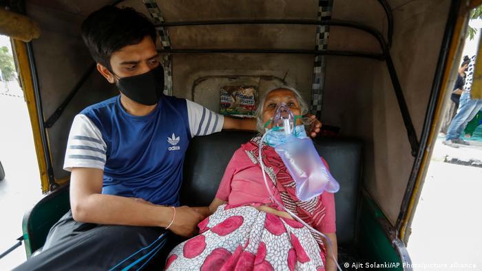 An Indian coronavirus patient in a ricksha