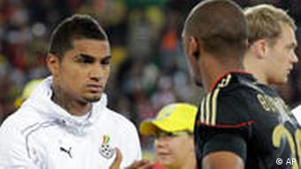 Kevin-Prince and Jerome Boateng shake hands before the match