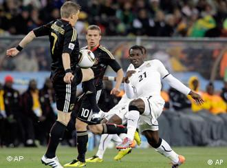 Germany's Bastian Schweinsteiger, left, Germany's Lukas Podolski, center, and Ghana's Kwadwo Asamoah fight for the ball during the World Cup group D soccer match between Ghana and Germany at Soccer City in Johannesburg, South Africa, Wednesday, June 23, 2010. (AP Photo/Gero Breloer)