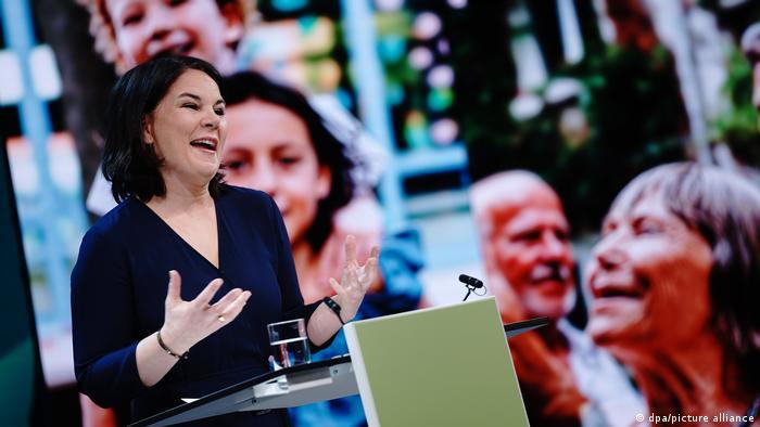 A smiling Annalena Baerbock giving a speech