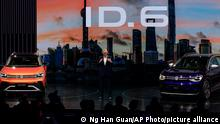 Stephan Wollenstein, CEO of Volkswagen Group China, introduces the ID 6 SUVs during a launch event at the Shanghai Auto Show in Shanghai on Monday, April 19, 2021. Volkswagen unveiled the electric SUV made for China ahead of the opening Monday of the Shanghai auto show, the industry's biggest marketing event in a year overshadowed by the coronavirus pandemic. (AP Photo/Ng Han Guan)