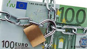 A 100 euro banknote with a chain and padlock around it.