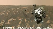 April 8, 2021 - Mars Surface - NASA's Perseverance Mars rover took a selfie with the Ingenuity helicopter, seen here about 13 feet (3.9 meters) from the rover. This image was taken by the WATSON camera on the rover's robotic arm on April 6, 2021. NASA's Perseverance Mars rover took a selfie with the Ingenuity helicopter, seen here about 13 feet (4 meters) away in this image from April 6, 2021, the 46th Martian day, or sol, of the mission. Perseverance captured the image using a camera called WATSON (Wide Angle Topographic Sensor for Operations and eNgineering), part of the SHERLOC (Scanning Habitable Environments with Raman and Luminescence for Organics and Chemicals) instrument, located at the end of the rover's robotic arm. (Credit Image: © NASA/JPL-Caltech/ZUMA Wire/ZUMAPRESS.com