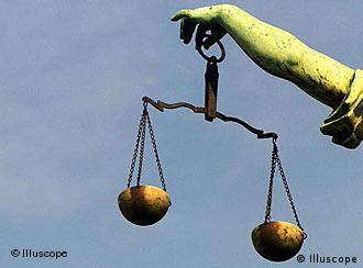 A scale held by a statue of Lady Justice