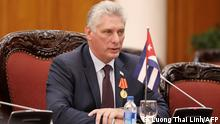 (FILES) In this file photo taken on November 09, 2018 Cuba's President Miguel Diaz-Canel Bermudez (C) speaks during a meeting with Vietnamese Prime Minister Nguyen Xuan Phuc (not pictured) at the Government Office in Hanoi. - Born after the victory of the 1959 revolution, Miguel Diaz-Canel, president and now first secretary of the Communist Party, embodies the new generation in power in Cuba, more connected but not necessarily more flexible. (Photo by LUONG THAI LINH / POOL / AFP)