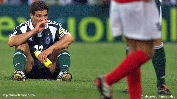 German forward Paolo Rink (L) reacts after the Euro 2000 group A soccer championship match
