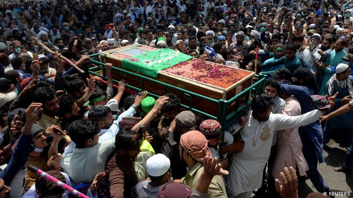 People attend the funeral of a TLP supporter in Lahore