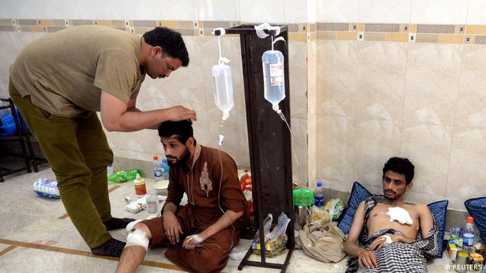 Protesters receive medical aid at a mosque in Lahore