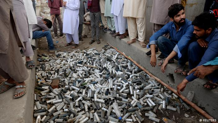 Protesters display a pile of used teargas canisters