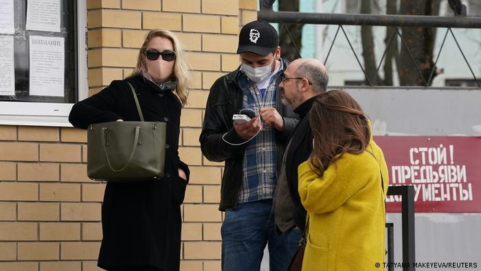 Navalny's personal doctor, Anastasiya Vasilyeva (left), is seen outside the penal colony which houses a hospital where the the opposition leader is currently located