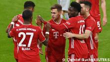 Soccer Football - Bundesliga - Bayern Munich v Bayer Leverkusen - Allianz Arena, Munich, Germany - April 20, 2021 Bayern Munich's Joshua Kimmich celebrates scoring their second goal with teammates Pool via REUTERS/Christof Stache DFL regulations prohibit any use of photographs as image sequences and/or quasi-video.