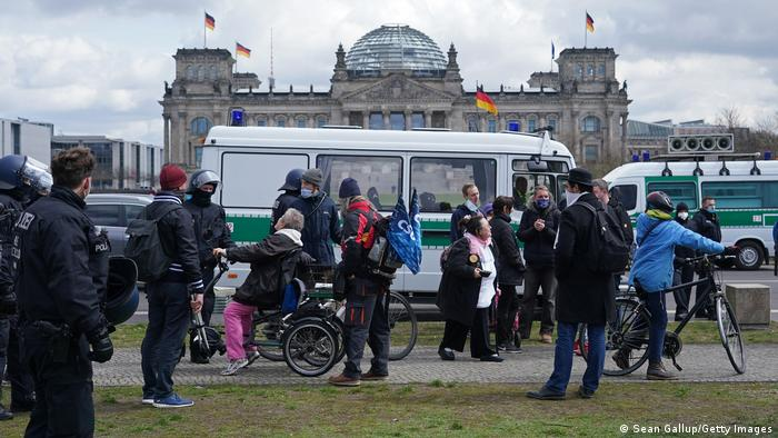 Police disperse protesters who had gathered near the Reichstag and the Chancellery